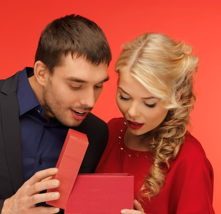 picture of man and woman looking inside the box photo