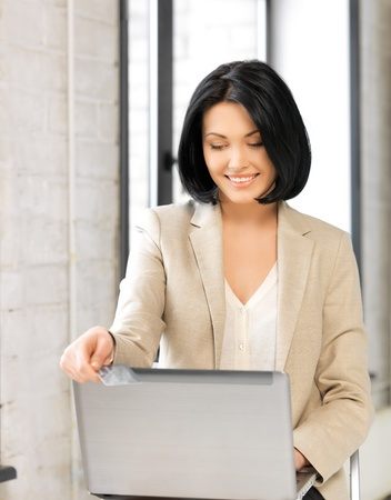 picture of happy woman with laptop computer and credit card Stock Photo - 17193750