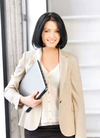 bright picture of happy woman with laptop computer Stock Photo - 17193752