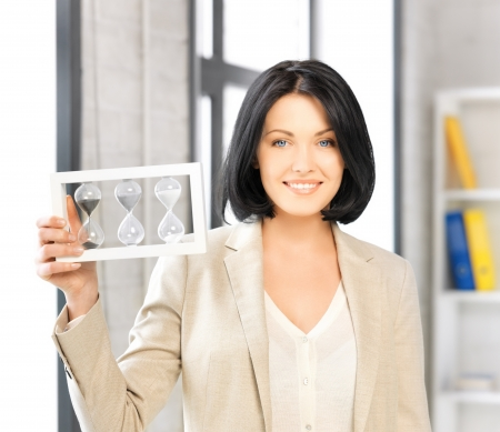 picture of attractive businesswoman holding hourglass  photo