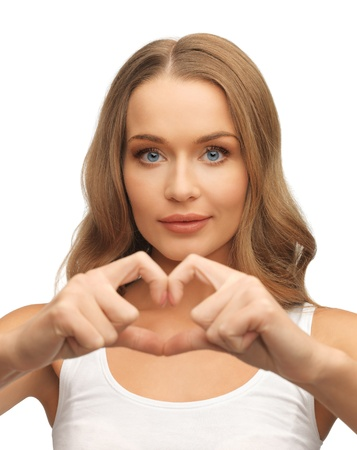picture of beautiful woman forming heart shape photo