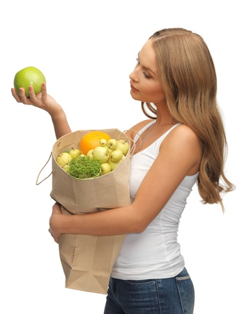 picture of woman with shopping bag full of fruits photo