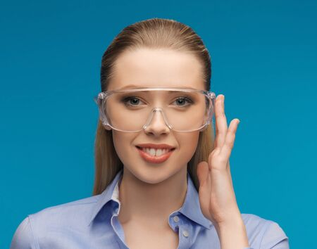 bright picture of businesswoman in protective glasses photo