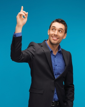 picture of man in suit with his finger up  photo