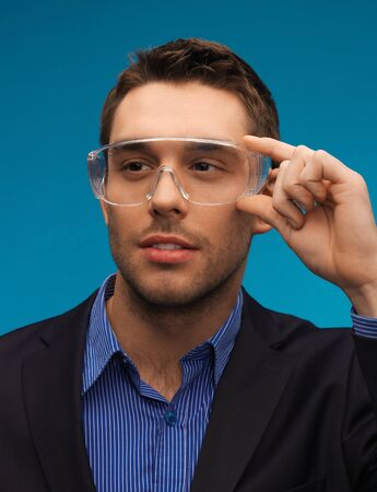 picture of handsome businessman in protective glasses  photo