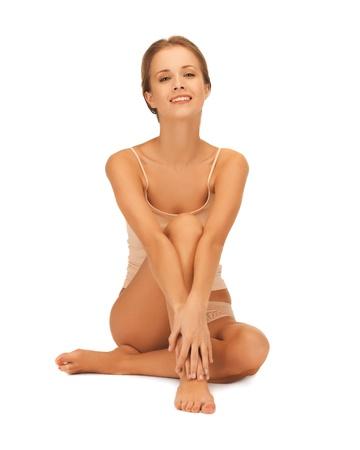 chiropody: beautiful woman in cotton underwear touching her legs