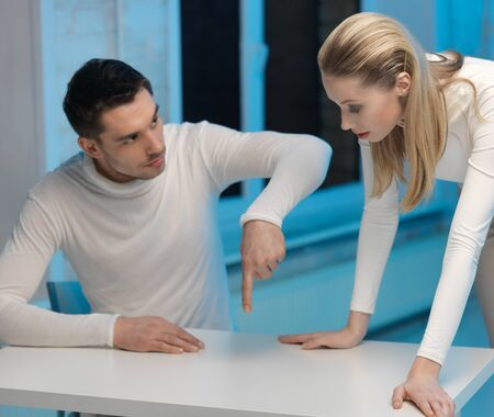 picture of man and woman working with something imaginary Stock Photo - 17237819
