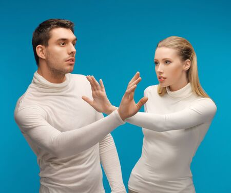 picture of man and woman working with something imaginary Stock Photo - 17237841