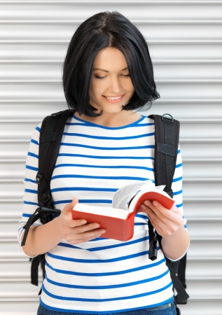 bright picture of attractive woman with bag and book   photo