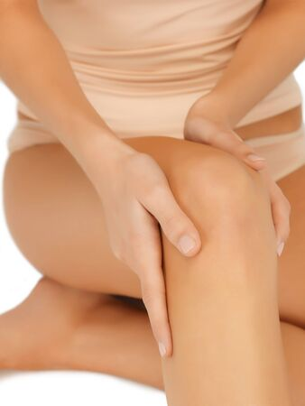 beauty parlor: closeup picture of female hands touching knee
