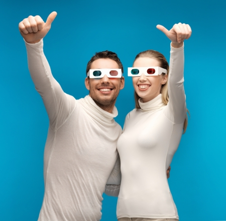 man and woman with 3d glasses showing thumbs up photo