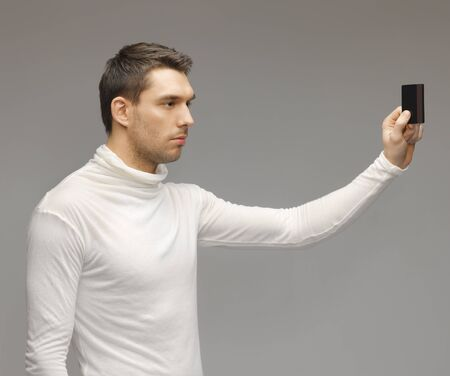 futuristic man: picture of futuristic man with access card