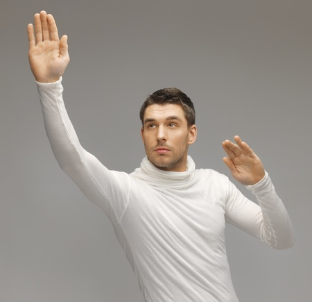 picture of futuristic man working with something imaginary Stock Photo - 17342941