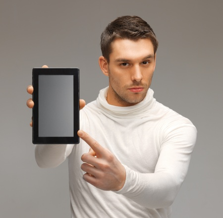 bright picture of futuristic man with tablet pc Stock Photo - 17287851