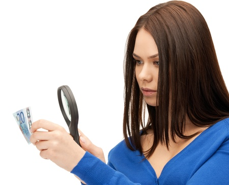 beautiful woman with magnifying glass and euro cash money   photo