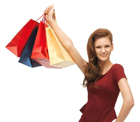 picture of happy teenage girl with shopping bags photo