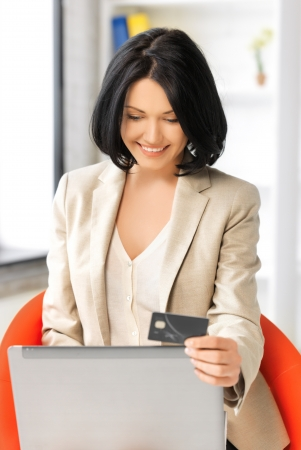 picture of happy woman with laptop computer and credit card Stock Photo - 17324484