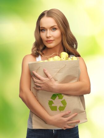picture of woman with shopping bag full of apples photo