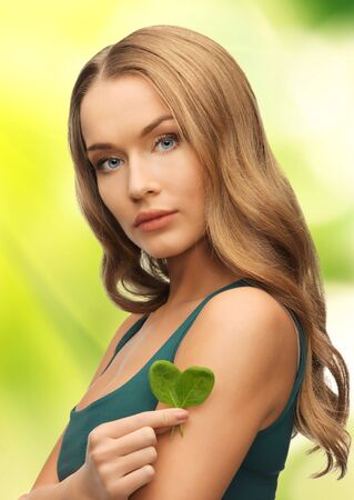 bright picture of woman with spinach leaves on palms Stock Photo - 17498232