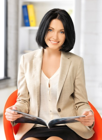 picture of attractive businesswoman with magazine  photo