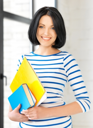 picture of happy teenage girl with books and folders photo