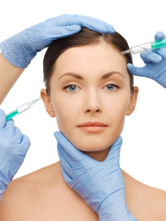 picture of woman face and beautician hands with syringe photo