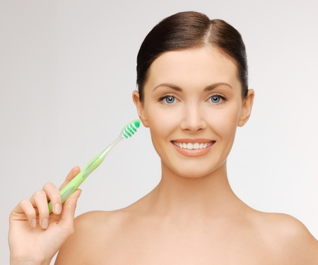 oral hygiene: bright picture of beautiful woman with toothbrush