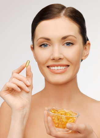 bright picture of beautiful woman with vitamins Stock Photo - 17370240