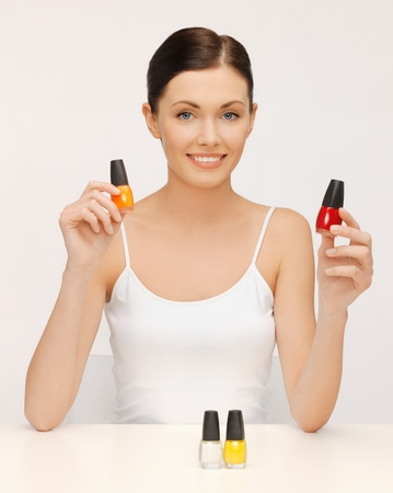 picture of beautiful woman with nail polish bottles photo
