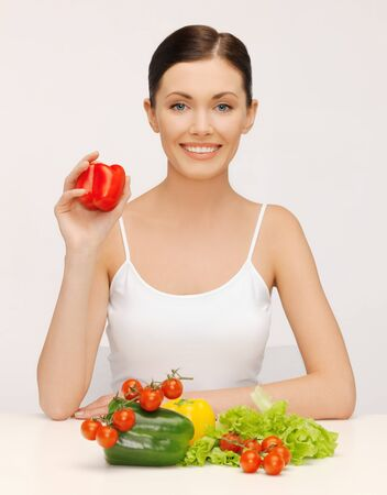 bright picture of beautiful woman with vegetables photo
