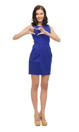 heart failure: picture of woman in blue dress showing heart shape Stock Photo