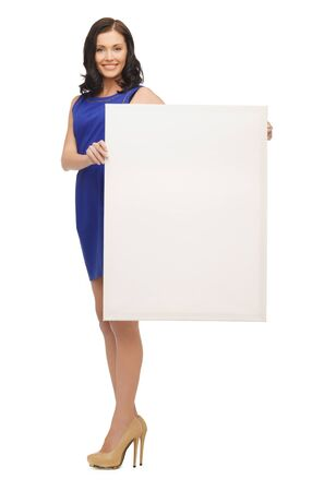 picture of lovely woman in blue dress with blank board photo