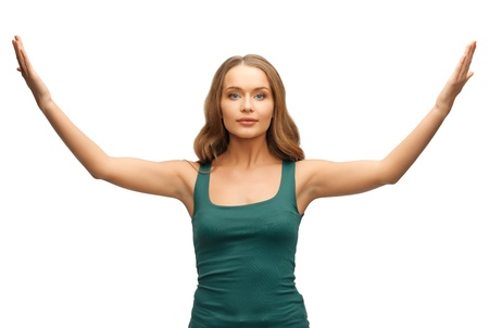 picture of calm and serious woman spreading hands  photo