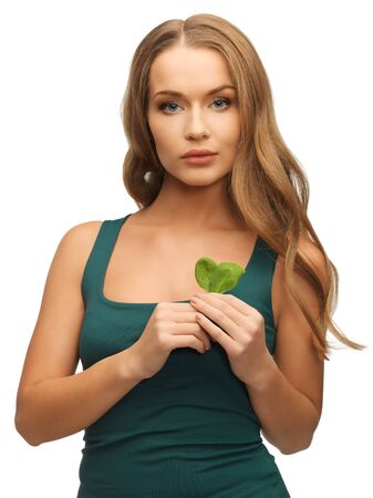 bright picture of woman with spinach leaves photo