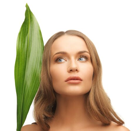picture of woman with green leaf over white  photo