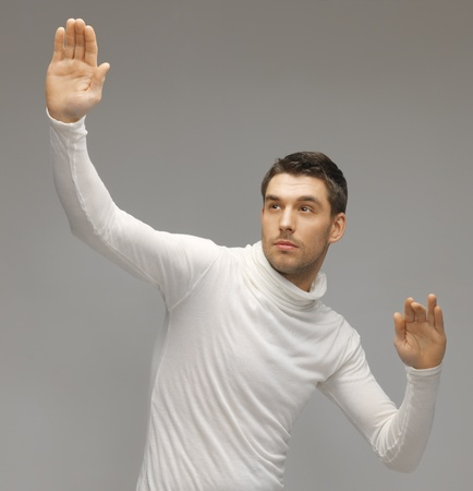 picture of futuristic man working with something imaginary Stock Photo - 17370281