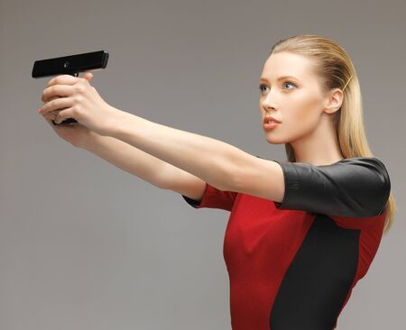 bright picture of futuristic woman with gadget photo