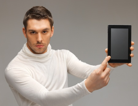bright picture of futuristic man with tablet pc photo