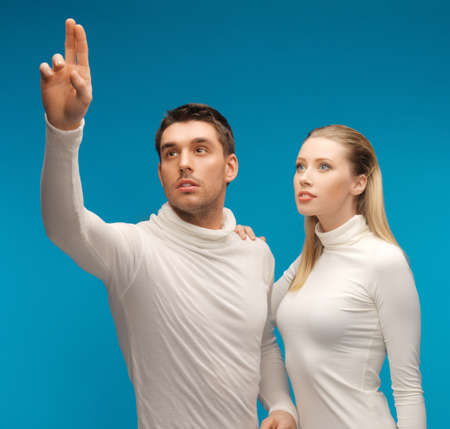 picture of man and woman working with something imaginary Stock Photo - 17370257