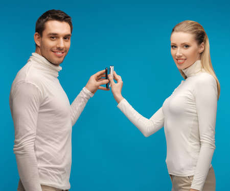picture of man and woman with modern gadgets photo