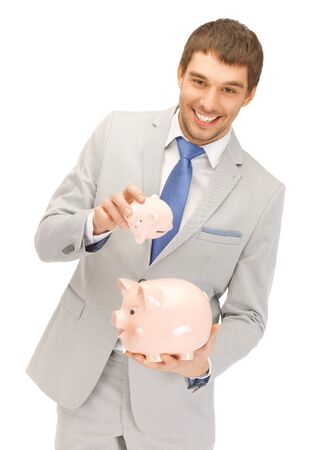 picture of handsome man with two piggy banks    photo