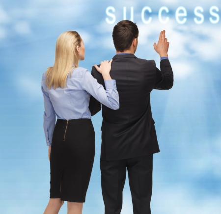 picture of man and woman with success word button in the sky photo