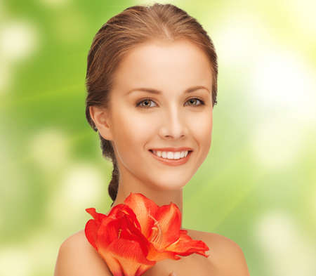 bright picture of lovely woman with red lily flower Stock Photo - 17450229