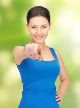 bright picture of beautiful woman pointing her finger photo