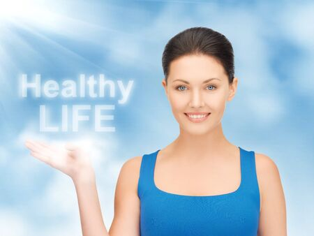 picture of woman holding healthy life words on the palm Stock Photo - 17450187