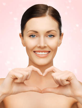 bright picture of beautiful woman showing heart shape Stock Photo - 17450272
