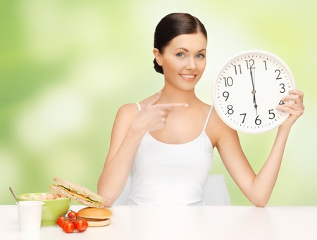 oclock: picture of beautiful woman with big clock