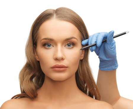 correction: picture of woman face and beautician hands with pencil Stock Photo
