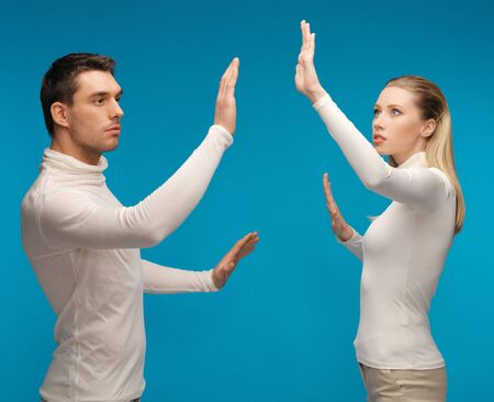 picture of man and woman working with something imaginary Stock Photo - 17450210