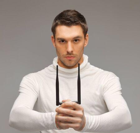 futuristic man: bright picture of futuristic man with gadget